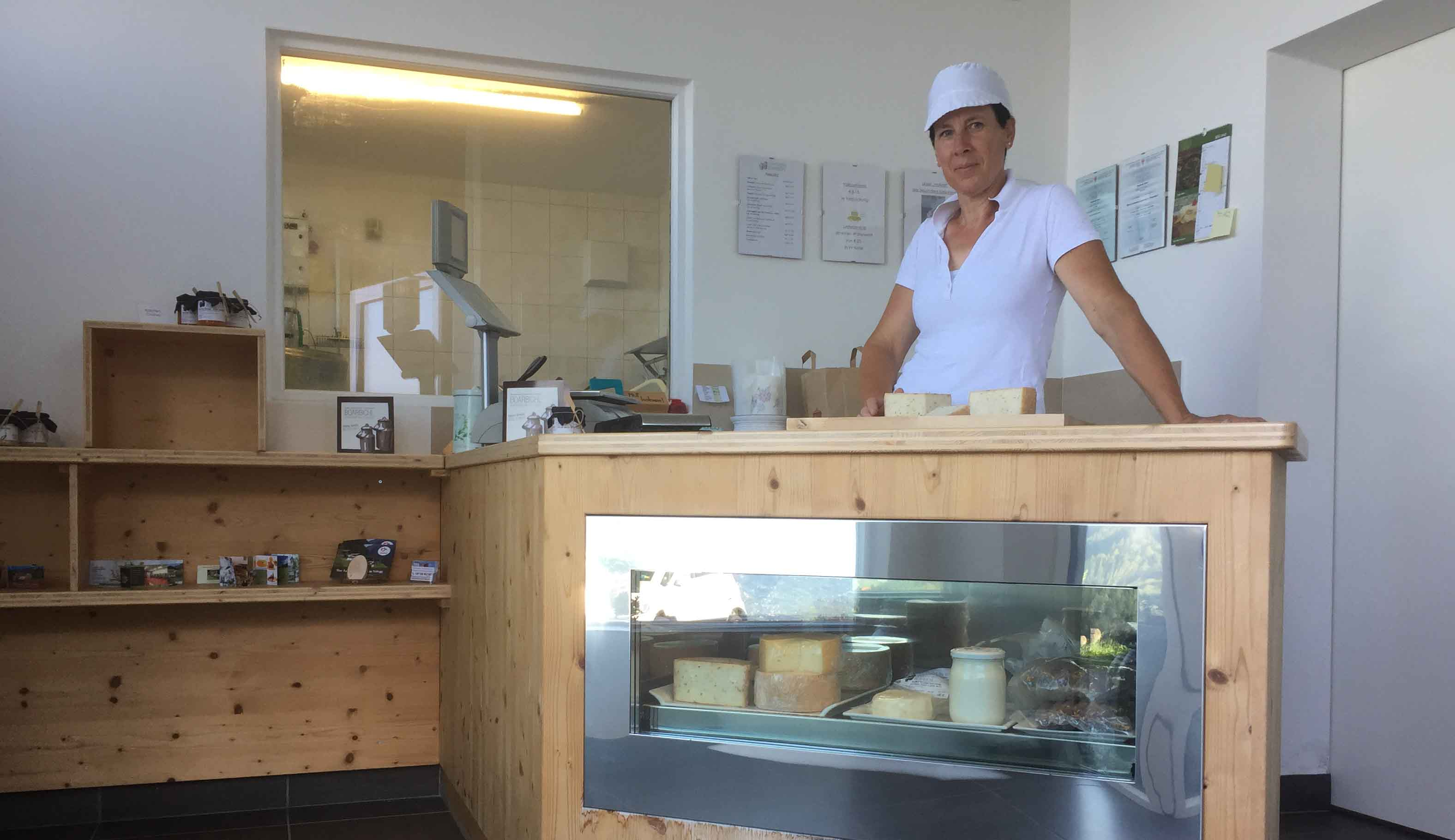 This is Sieglinde from Schenna South Tyrol. She lives on a farm on top of the mountains and is making all sort of cheese there. This is Sieglinde in her cheese shop where she sells cheese.