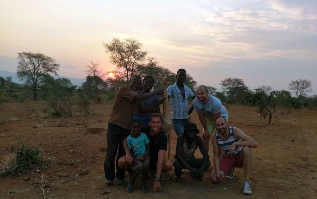 This is a sunset in Malawi and a picture with a handmade wooden giraffe.