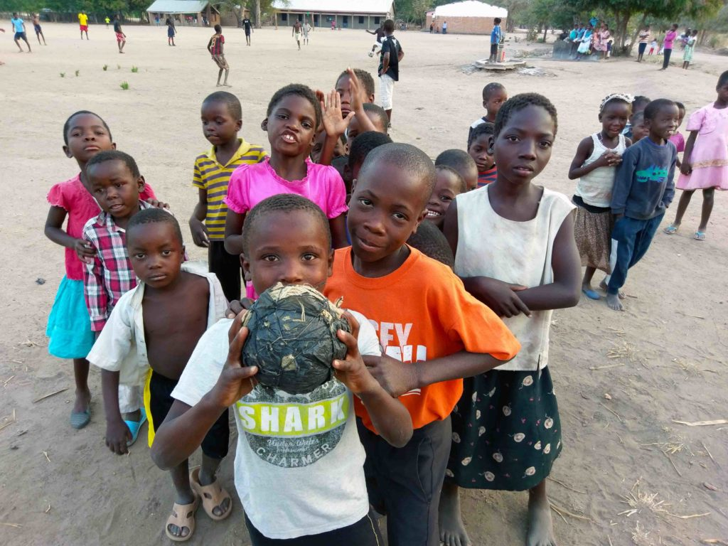 These are kids from Malawi with a soccer made of paper and tape.