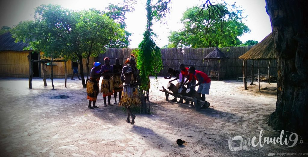 This is a traditional village in Namibia. The medicine man did a traditional dance for us. While he danced he fell into trance. In order to wake him up the woman of the village emptied a basket full of cold water over his head.