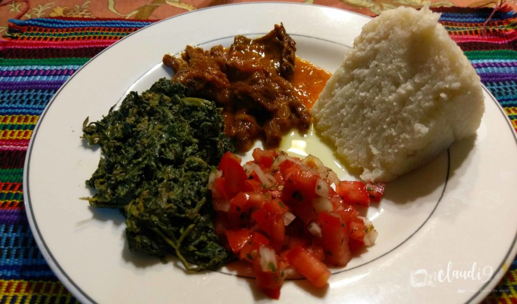 This is Aliya, Osuga, Kachumbari and Ugali, a traditional Kenyan dish.