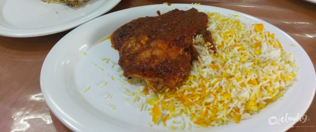 This is Chicken Biryani and rice, a traditinal Kenyan dish.