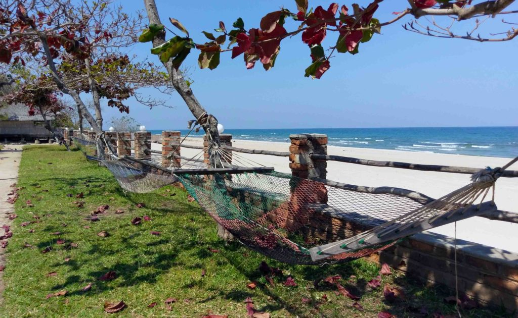 This is a hammock and the beach of Kande Beach in the north of Malawi.