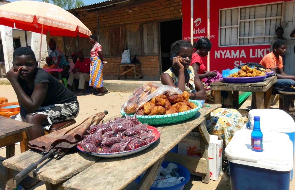 This is traditional food they sell at the market in Malawi. You can see peanuts and Mandazi.
